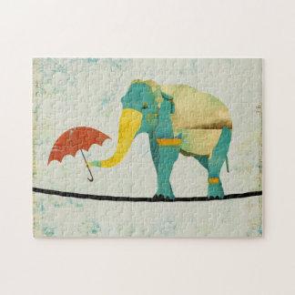 Quebra-cabeça gracioso dourado do elefante