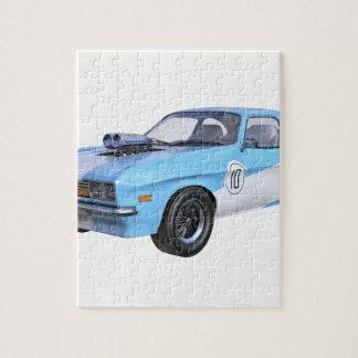 Quebra-cabeça os anos 70 azuis e carro branco do músculo