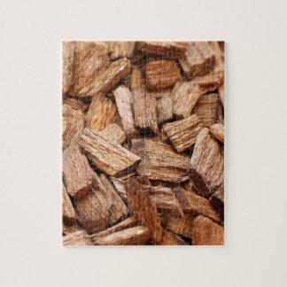 Quebra-cabeça Pilha de partes de madeiras secas de tamanhos