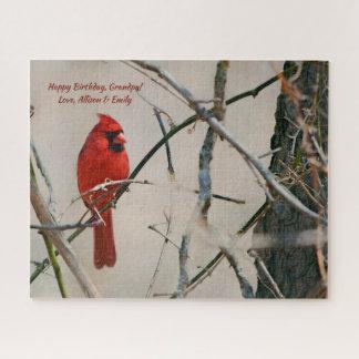 Quebra-cabeça Um pássaro cardinal vermelho em um ramo nas