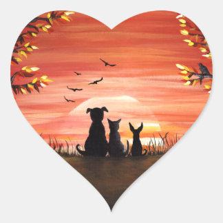Queda do cão e gato do por do sol do outono adesivo coração