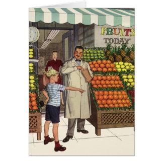Quitandeiro e menino do negócio do vintage pelo cartão comemorativo
