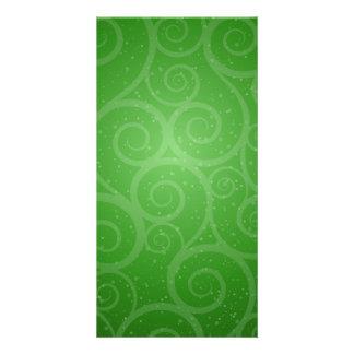 Redemoinhos verdes do fundo cartão com foto