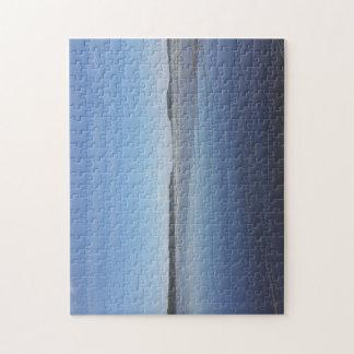 Reflexões azuis do quebra-cabeça da foto da baía