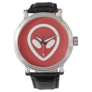 Relógio A alienígena minimalista está olhando-o