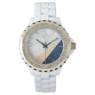 Relógio bloco azul da cor do pêssego de mármore branco