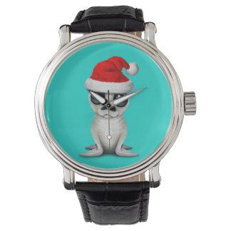 Relógio De Pulso Selo ártico do bebê que veste um chapéu do papai