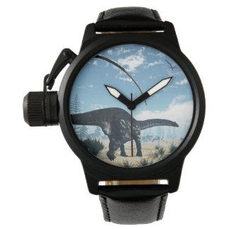Relógio Dinossauro do Apatosaurus no deserto - 3D rendem