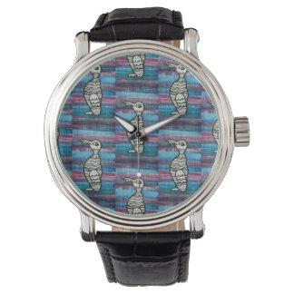 Relógio do Auk com fundo do azul e da ameixa