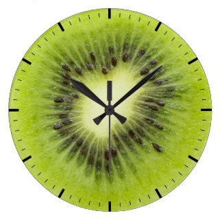 Relógio Grande Fruta de quivi fresca. Close up redondo da fatia