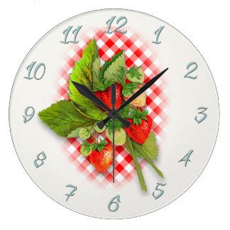 Relógio Grande Guingão e morangos vermelhos do país