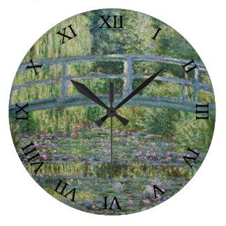 Relógio Grande Lírios japoneses da ponte e de água por Claude