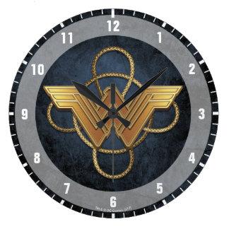 Relógio Grande Símbolo do ouro da mulher maravilha sobre o laço