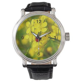 Relógio Joaninha amarelo do vermelho da boa sorte da flor