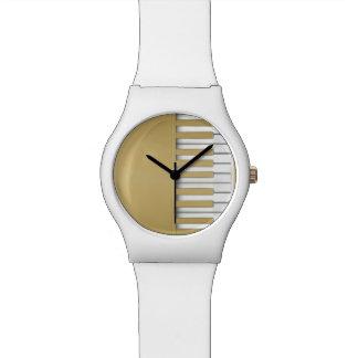Relógio Música do teclado de piano do ouro