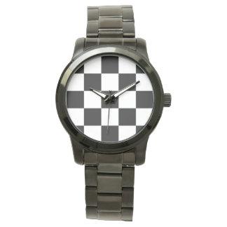 Relógio preto e branco do tabuleiro de damas