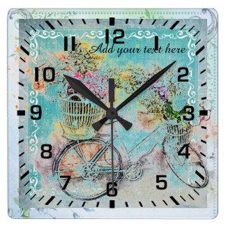 Relógio Quadrado Bicicleta com as cestas da flor na serapilheira