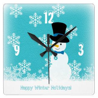 Relógio Quadrado Boneco de neve engraçado branco azul com flocos de