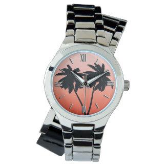 Relógio Silhueta da palmeira na laranja do por do sol