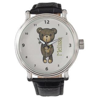 Relógio Urso marrom bonito que mantem uma flor amarela