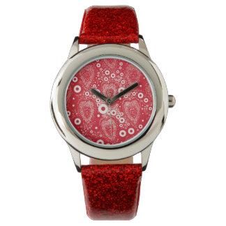 Relógio vermelho das bolhas e dos corações para