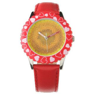 Relógio vermelho dos corações do girassol