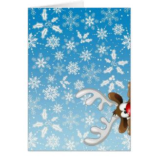 Rena bonito e flocos de neve no cartão de Natal