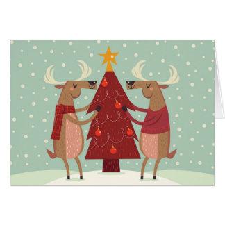 Rena que decora o cartão do feriado da árvore de