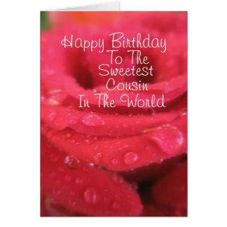 Rosa vermelha com o cartão de aniversário do primo