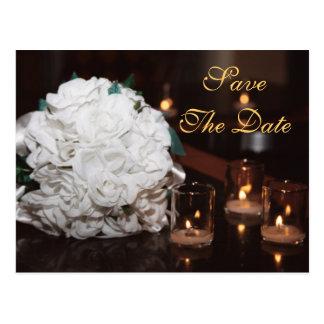 Rosas brancos & economias da luz de vela o cartão
