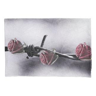 rosas e arame farpado