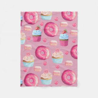 Rosquinhas, cupcakes, e doces cor-de-rosa cobertor de lã
