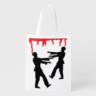 Saco da doçura ou travessura do zombi e do sacola ecológica