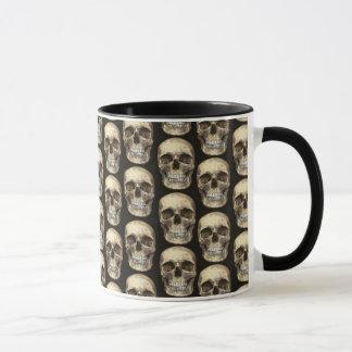 Saco do copo humano da caneca de café do crânio