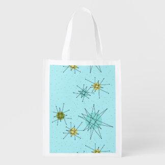 Sacola Ecológica A bolsa de compra atômica azul de Starbursts do
