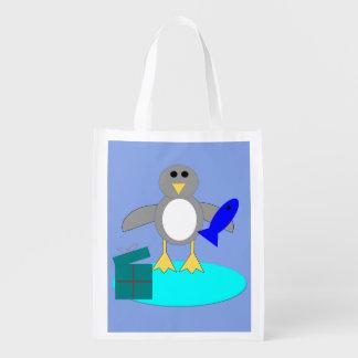 Sacola Ecológica Feliz Natal que pesca o saco reusável do pinguim