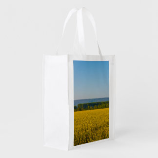 Sacola Ecológica um campo da colza amarela no saco reusável