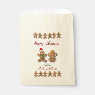 Sacolinha Biscoitos do pão-de-espécie que comemoram o Natal