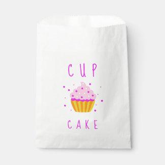 Sacolinha O género cor-de-rosa do cupcake da menina revela o