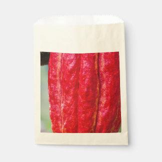 Sacolinha vermelho do vagem do cacau