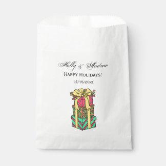 Sacolinha Xmas envolvido empilhado dos presentes de Natal