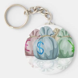 Sacos do saco do dinheiro que contêm moedas chaveiros