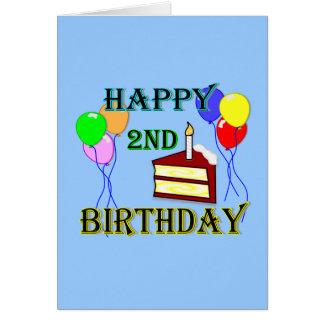 Segundo aniversário feliz com bolo, balões e vela cartões
