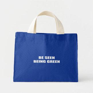 Seja visto ser verde bolsas para compras