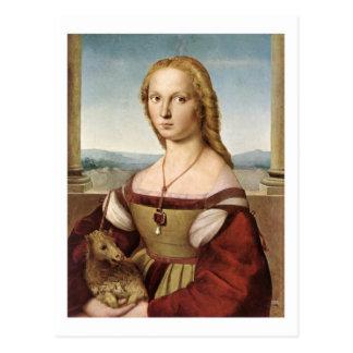Senhora com um cartão do unicórnio