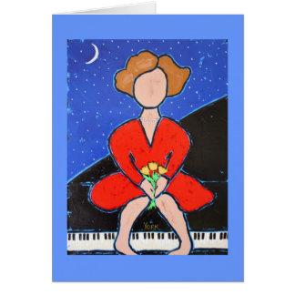 senhora no cartão do piano