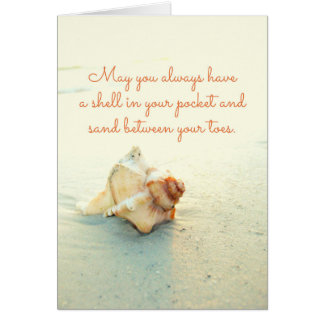 Shell em seu bolso lixa entre o cartão da praia