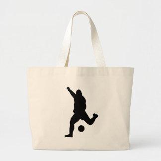 Silhueta do pontapé do futebol bolsas de lona