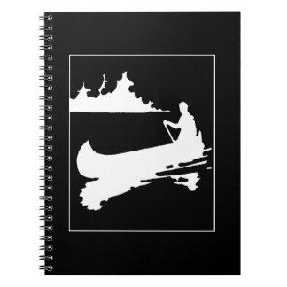 Silhueta retro da canoa cadernos