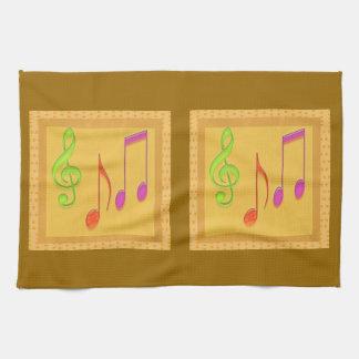 Símbolos de música baixos dourados da dança pano de prato